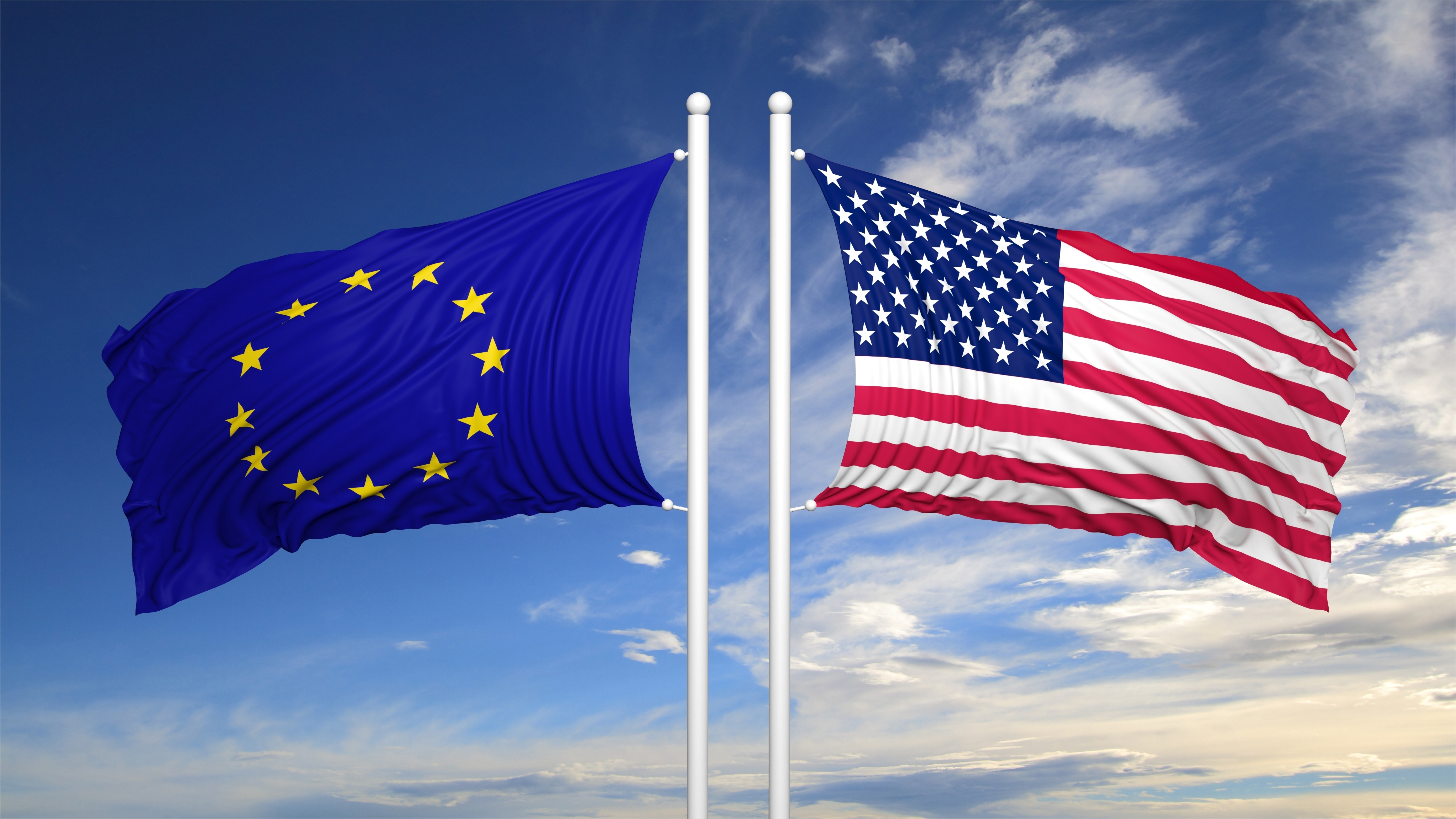 American and European flags waving against of sky