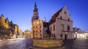 Night view of Poznan Old Market Square in western Poland. Panoramic montage from 5 HDR images
