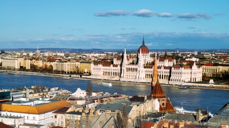 Budapest, Hungary. Aerial view of the old city Budapest, Hungary with river and Parliament Building with cloudy blue sky
