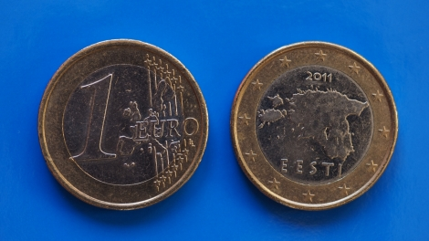 1 euro coin money (EUR) currency of European Union Estonia over blue background