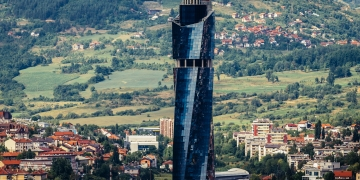 Sarajevo Bosnia and Herzegovina - August 24 2015. View from Vraca Memorial Park with building of Avaz Twist Tower