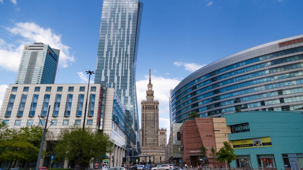 WARSAW, POLAND - MAY 07, 2016: Building Palace of Culture and Science among the modern buildings of the city