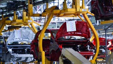 Car bodies on the production line inside automobile factory