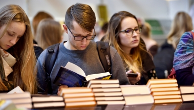 VILNIUS - FEBRUARY 25: Many people choose books at the indoor book