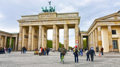 Brandenburg Gate in Berlin in Germany. The Brandenburg Gate is a triumphal arch a city gate in the center of Berlin. It is one of the most known sites in Berlin.