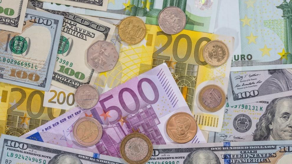 dollar pound euro coin on euro background.