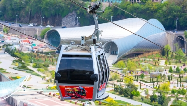 Tbilisi, Georgia - April 29, 2017: Tbilisi red cable car fulicular cabin and aerial city skyline panoramic view