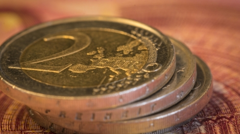 Euro money: Macro view of euro coin and bill. Suitable for financial, monetary, euro or European Union concepts and ideas