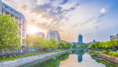Dambovita river and center of Bucharest at sunset time Romania.