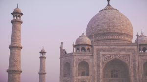 Amazing view on the Taj Mahal in sunset light with reflection in water. The Taj Mahal is an ivory-white marble mausoleum on the south bank of the Yamuna river. Agra Uttar Pradesh India.