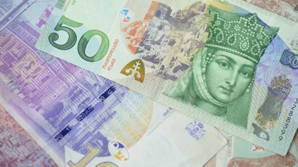 Background of Georgian Lari banknotes close up