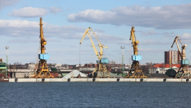Industrial dock with cranes on the quay