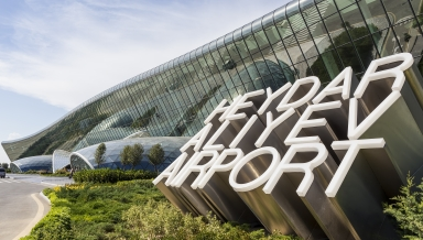 Azerbaijan Baku - September 16 2015: View of the Heydar Aliyev International Airport sign in Baku Azerbaijan. The airport is the home of Azerbaijan Airlines the national flag carrier.