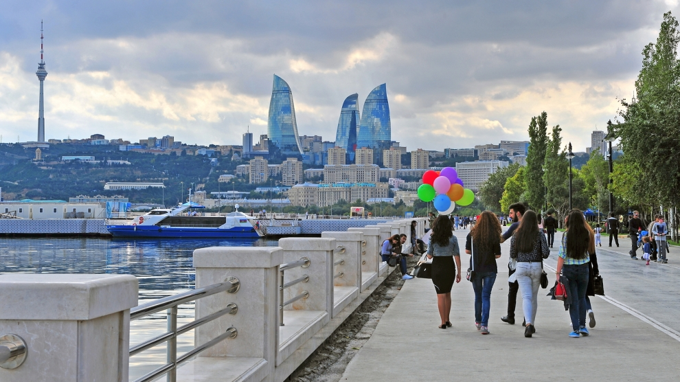 BAKU AZERBAIJAN - SEPTEMBER 25: People goes by the seafront of Baku on September 25 2016. Baku is a capital and largest city of Azerbaijan.