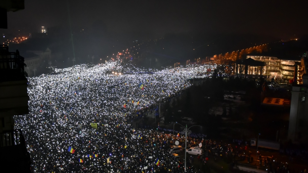 """BUCHAREST, ROMANIA - 05 February 2017: More than 240,000 protesters in Victory Square (Piata Victoriei). """"Torches"""" moment. At 09:00PM Romanian protesters shone torches on their phones."""