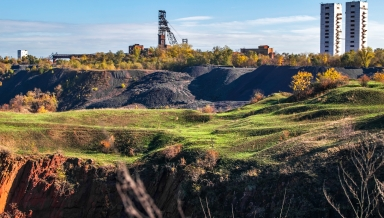 Landscape with two mine head frames . Ukraine, Kryvyi Rih, Iron-ore mine Gvardeiskaya. An autumn sunny day with blue sky. Complex for Mining