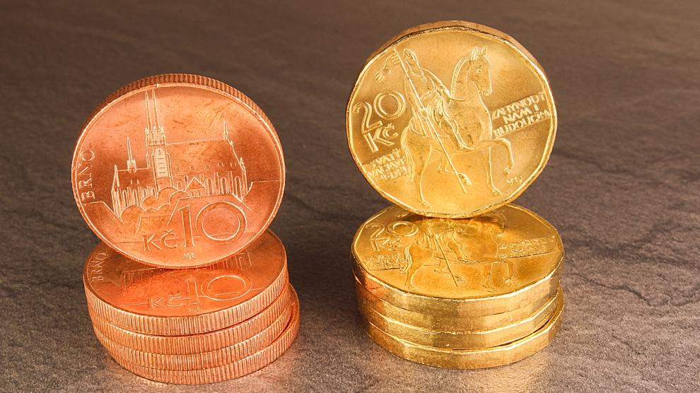 Ten czech crown coins money on black marble background