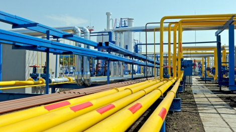 Yellow gas pipes in natural gas treatment plant in bright sunny summer day