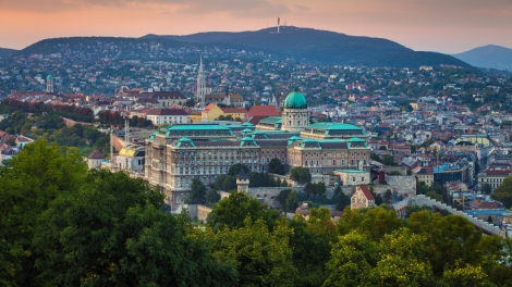 Budapest Hungary - Panoramic skyline view of the famous Buda Castle Royal Palace with the Buda Hills and Matthias Church at background at sunset