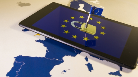 Padlock and EU flag inside smartphone and EU map, symbolizing the EU General Data Protection Regulation or GDPR. Designed to harmonize data privacy laws across Europe.