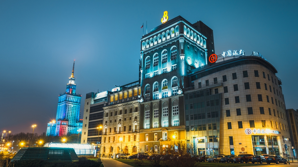 Warsaw, Poland, March 12, 2016: Night view of downtown with the PAST building and Bank of China