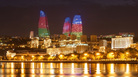 BAKU AZERBAIJAN - SEPTEMBER 15 2016: Baku Flame Towers at night. It is the tallest skyscraper in Baku Azerbaijan with a height of 190 meters.
