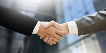 M&A (MERGERS AND ACQUISITIONS) Businessman handshake working at office M&A