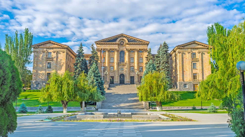 The light orange tuff building of Armenian Parliament located on the hill in Kond District Yerevan Armenia.