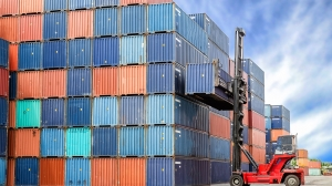 Import Export Logistics concept - Crane lift up container box loading to container depot use for cargo import export logistics background