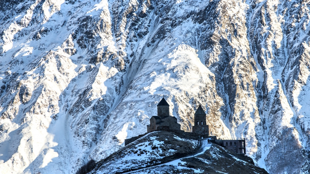 Holy Trinity Church (XIV century) at an altitude of 2170 m in Gergeti, Georgia