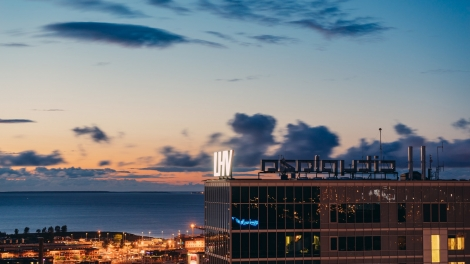 Tallinn Estonia - December 13 2017: Headquarter of LHV bank against modern architecture of city centre district.
