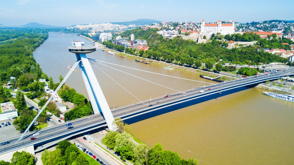 SNP New Bridge through Danude river aerial panoramic view in Bratislava. Bratislava is a capital of Slovakia.