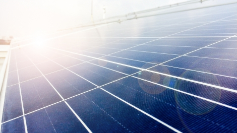 Soft focus of Solar panels or Solar cells on factory rooftop or terrace with sun light Industry in Thailand Asia. Can saving energy. Sun energy. renewable energy. Clean energy.
