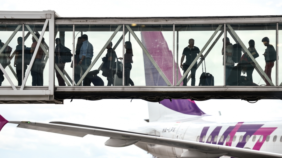 Passengers Boarding On Airplane at otopeni bucharest airport