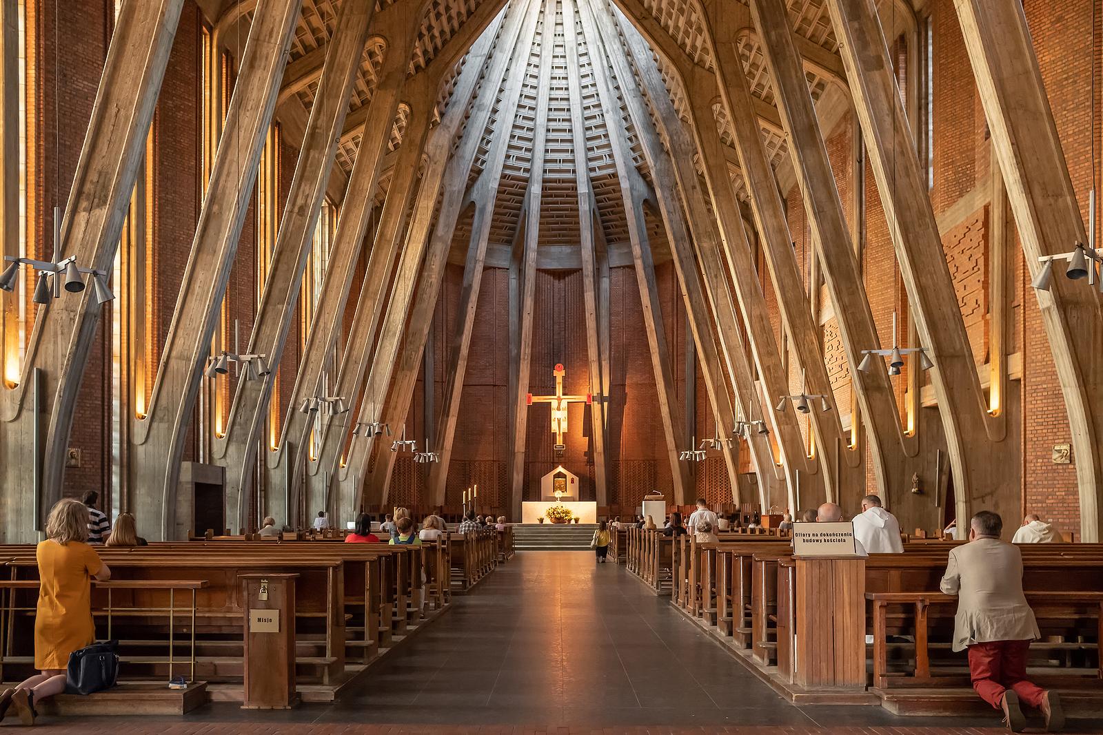 Poles pray inside a Warsaw church.