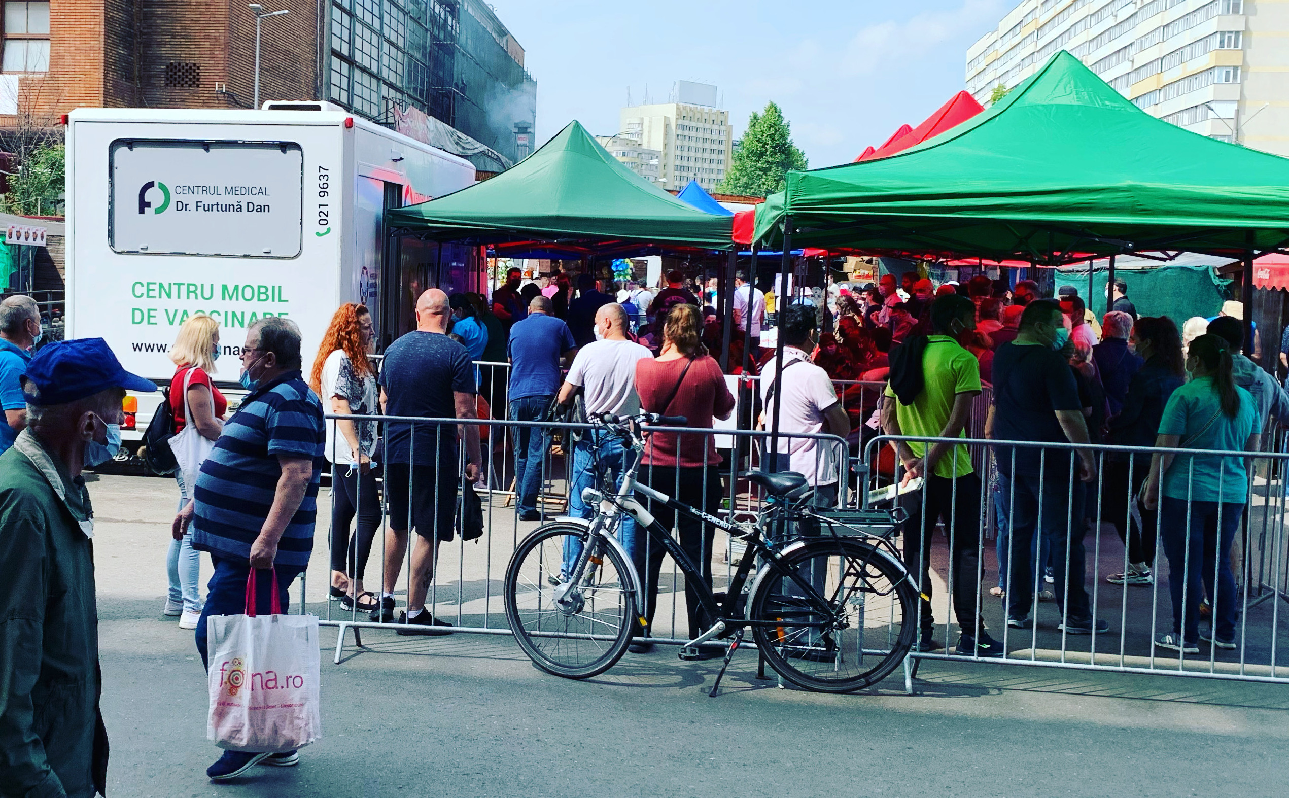 Queuing for vaccines in Bucharest's Obor market